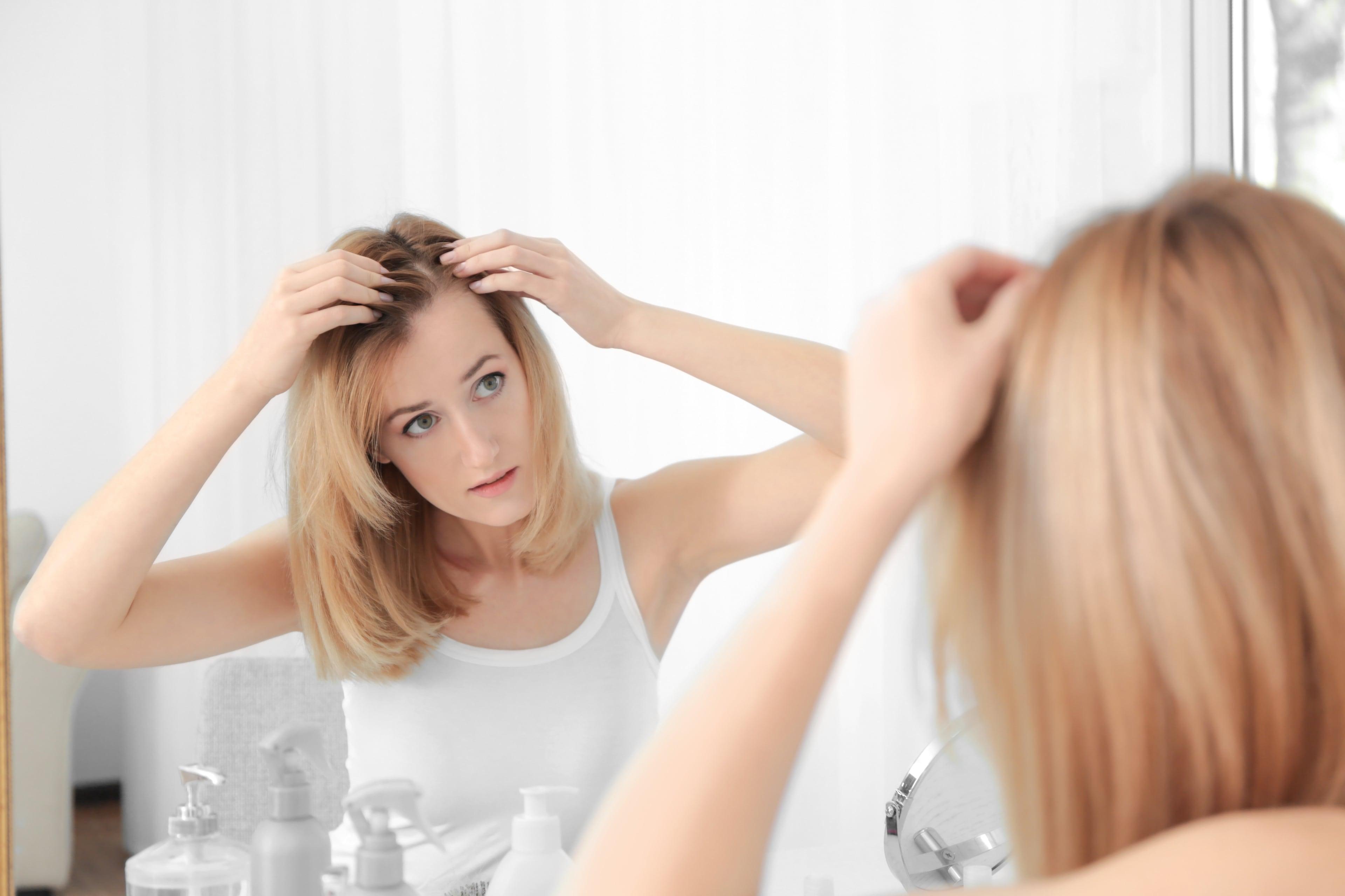 Выпадение волос у женщин: причины и методы лечения